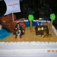 Pirates Of The Carribbean This was for a little boy's birthday. I could not show it here, but I had a picture of him on one of the sails. Yellow cake with BC...