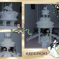 All White Wedding Cake Did this one for a friend and co-worker several years ago. All white Royal roses, stringwork, arches. White cherubs, and angels on the...