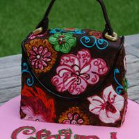 Vera Bradley Purse Cake Pattern on purse is copied from a Vera Bradley design. Cake covered in Fondant and painted.