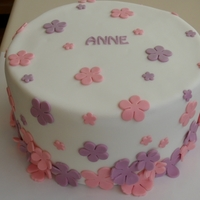 Flowers For Anne Chocolate buttermilk cake filled with white chocolate buttercream. Covered in ganache then fondant. Gumpaste decorations. The little...