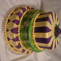 New Years Eve/ Mardi Gras Themed Cake Iced in buttercream, airbrushed, covered in gold fondant decorations