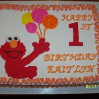 100_3043.jpg This is an Elmo cake that I did for my niece's first birthday. I used fondant for Elmo and for the number one. The rest is buttercream...