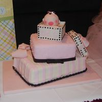 The Greatest Gift Stacked cakes covered and decorated with fondant to make presents. Baby head is made from rice crispy treats and covered with fondant. Top...