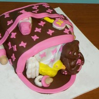 "Brown & Pink Diaper Bag Cake  8"" square vanilla cake, chocolate ganache filling, vanilla buttercream, chocolate fondant and pink vanilla fondant, rice krispie treat..."