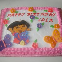 Dora Birthday Cake This was a cake for my friends 3 year old daughter. Her aunt actually made the cake, I did the dora color flow and the fondant butterflies...