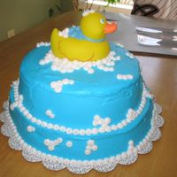 "Rubber Ducky Cake Cake is chocolate. BC icing and ""bubbles"". Ducky is real. This cake got rave reviews at the restaurant the shower was held at!..."