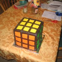 "Rubik's Cube I just finished this! It's for an 80's party tonight! Four 8"" layers....alternating white and chocolate with a cookies and..."