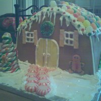 Gingerbread Cake She wanted a cake to look like a gingerbread house for a Christmas party. All fondant and candy decorations