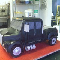 Big Truck This is a huge international pickup truck that we made at the bakery i work for. All carved from cake no styro here DUFF!