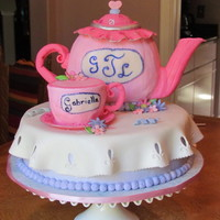 Tea Party Gabriella turned 4 and celebrated with a tea party inviting all her friends. Fondant used for the handles, spout and lid, used pumpkin cake...