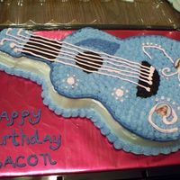 Hannah Montana Guitar This was carved from a sheet cake from a guitar picture I found on the internet. All buttercream