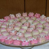 Baby Dedication I made these for my niece's baby dedication reception. They are white cake with poured fondant icing.