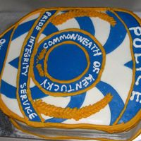Owensboro Police Cake 1/2 sheet cake carved to resemble opd shoulder patch. Fondant and piped with buttercream