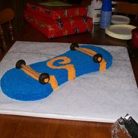 Skateboard Birthday Cake   Cake for my nephew, he loved it. Buttercream, donuts and those wafer thingies.