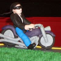 Biker Closeup  Close-up photo of figure / motorcycle. Both bike and biker are made of fondant. Used pieces of bamboo skewers and shaped wire for...