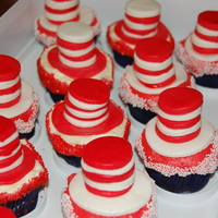 Happy Birthday, Dr. Seuss 'Cat in the Hat' cupcakes I made for my son's preschool class to celebrate Dr. Seuss's birthday. Buttercream frosting...