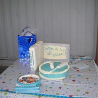 Wii Birthday Cake My husband and I made this for our son's friend's birthday. The blue round is white cake with BC icing, TV cake in the back is...