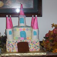 Castle Cake Bottom layer is 9X13 double decker false cake, Round center is 2 layers of confetti cake with cream cheese icing filling. ferrels are rice...
