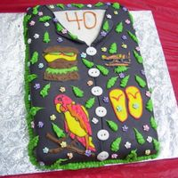 Jimmy Buffet Surprise Birthday Cake This was my first fondant covered cake. Designs on the shirt are hand drawn.