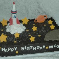 Rocket Ship   Rocket ship is fondant as well as the stars and planet. Moon and smoke is buttercream.