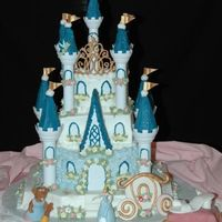 Cinderella's Castle  I made this for my 4 year old daughter. Didn't come out as nice as I wanted it tobut she was pleased. Coach is fondant. Pillow is...