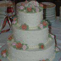 Round Wedding Cake   Cake was made to match the Lenox butterfly on the top of the cake. Cakeand flowers are all buttercream.