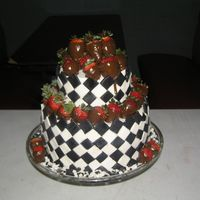 Black & White Affair   Birthday cake for a mans 36th birthday. 2 tier bottom double chocolate mocha and top tier butter.