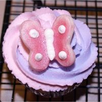 Butterfly Cupcake WASC Cupcakes swirled with pink and purple buttercream made for my daughters birthday. Butterflies are made out of candy clay. Thanks for...