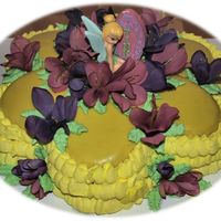Tink This is a cake I did for my daughter's 4th Birthday...Funfetti cake with Wilton's Ganache recipe. Their ganache is really good...