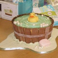 Ducky In Wooden Tub Wooden tub slats made with wood grain fondant. Duck is fondant, water is made from a homemade candy much like gummy worms. Looks and tastes...
