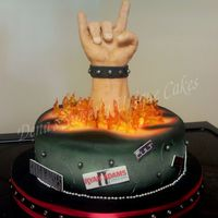 Fist Of Rock Cake This is my version of the Ace of Cakes Fist of Rock cake. It was requested for a birthday party and had to travel a good two hours for...