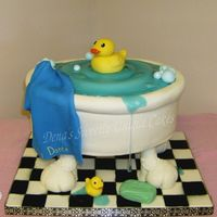 Duckie In A Bathtub 3-13 inch oval cakes. Holes were pre drilled in the board and large Wooden Dowels are screwed into a 14x18 3/4 inch plywood board AFTER THE...