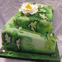 Green Shadow Faries Two tier tilted cake with shadowed fairies, airbrushing, fondant, gumpaste leaves and dew drops of hologram mixed in piping gel. Very...