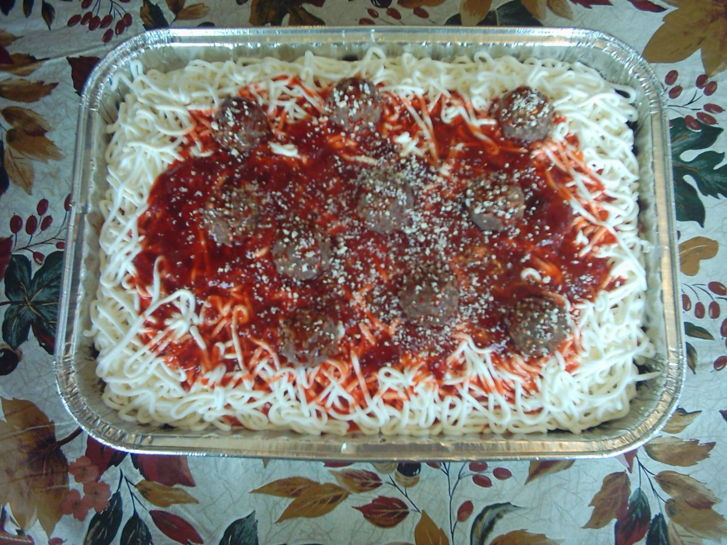 Spaghetti Cake  Yet another spaghetti cake. Thought this would be a good cake to try for a newbie. Buttercream noodles with strawberry topping as the sauce...