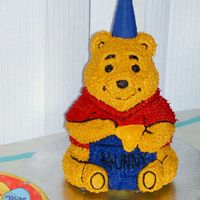 Winnie The Pooh Cake   I made this cake for my son's first b-day. 3-D pan was a little tricky.