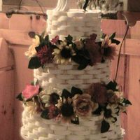 My First Wedding Cakes This is the first wedding cake I have ever made got the idea from the most recent Wilton Wedding Cakes book and my sister loved it. I was...