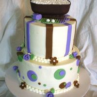 "Spa Party 6' and 8"" vanilla cake with purple batter marbled in. Buttercream with findand accents. Topper made of RKT, chocolate,..."