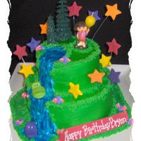 Dora Birthday Cake 2 tier Dora birthday cake. Bottome tier - yellow w/ bc filling. Top tier - chocolate w/ bc filling. Stars made out of fondant and brushed...