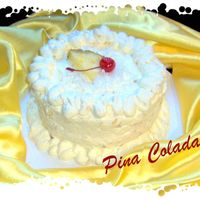 Pina Colada Cake White cake made with rum and pina colada mix. Pineapple coconut filling and icing made with coolwhip, pineapple, rum, pina colada mix and...