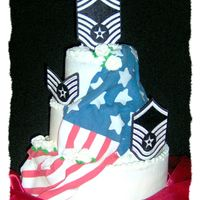 Air Force Promotion Cake 3 Tier: 12, 9, & 6. 12- White cake w/ raspberry filling....9-Devils food cake with whipped chocolate ganache filling......6-yellow cake...