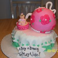 A Baby Is Brewing Baby shower tea party for a good friend. The teapot was made with the sports ball pan. Everything was covered with buttercream. The baby...
