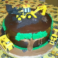 Construction Cake This cake was for my little boy's 3rd birthday. I bought the vehicles in a set from Wal-Mart and he LOVED his cake. he's been...