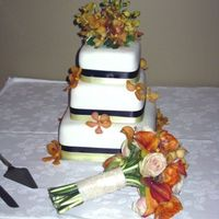 My Third Wedding Cake. Fondant with satin ribbon and fresh flowers.