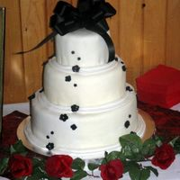 Black & White Wedding Cake This was my first 'real' wedding cake.. I had made one before but it was a dummy cake. Despite my best efforts, and quite a bit...