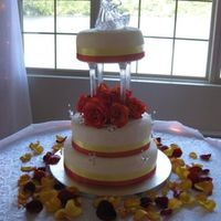 Round Wedding Cake Fondant covered cake, ribbon and crystal butterflies. The top tier had quite the lean to it unfortunately.. I levelled the cakes but didn&#...