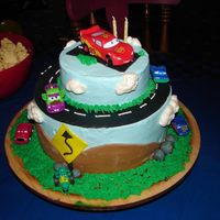 Grandson's 2Nd Birthday Lightning McQueen cake for my grandson who adores lightning McQueen. Cake is vanilla filled with chocolate ganache. Buttercream and fondan...