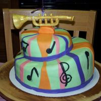 Niece's 13Th Birthday Cake WSAC with chocolate ganache filling. Trumpet made of gumpaste with brushed on gold pearl dust everything else fondant