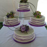 "Wedding Cake 6, 8, & 10"" cakes. Covered in fondant with real flowers and ribbon."