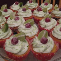 Cranberry Lime Cranberry Lime cupcake with sugared cranberry and lime wedge.