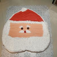 Santa Cake   I made this cake for my aunt's office party. It is a chocolate cake with buttercream icing.